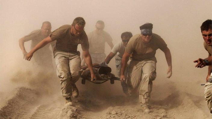 US troops pull a soldier to safety in Afghanistan, October 2010