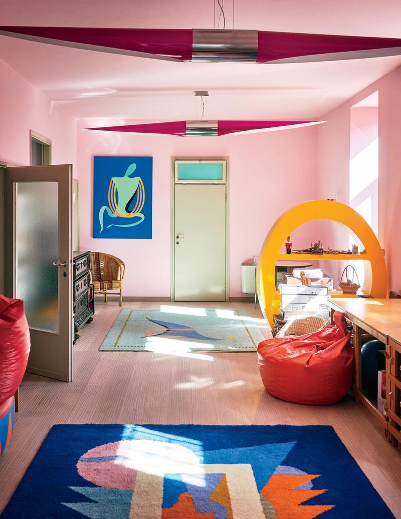 A colorful playroom in Mendini's vacation home features a painting, rug, and bookcase all by the designer.