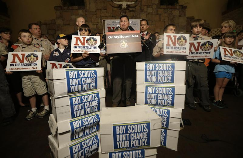 John Stemberger, center, leads a press conference backed by people against the proposed change in the Boy Scouts of America gay policy Wednesday, May 22, 2013, in Grapevine, Texas. Delegates to the Boys Scouts of America meeting nearby are expected to address a proposal to allow gay scouts into the organization. (AP Photo/LM Otero)