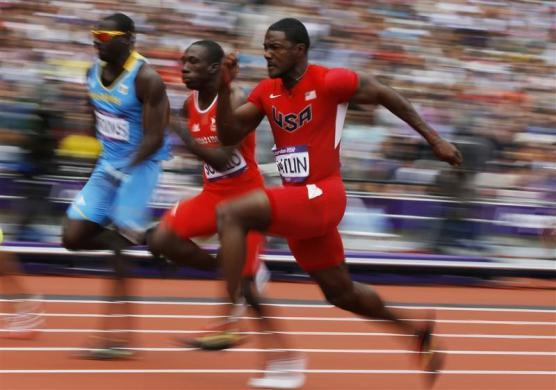 Justin Gatlin (R) of the U.S. runs on his way to winning in his men's 100m round 1 heat at the London 2012 Olympic Games at the Olympic Stadium August 4, 2012.