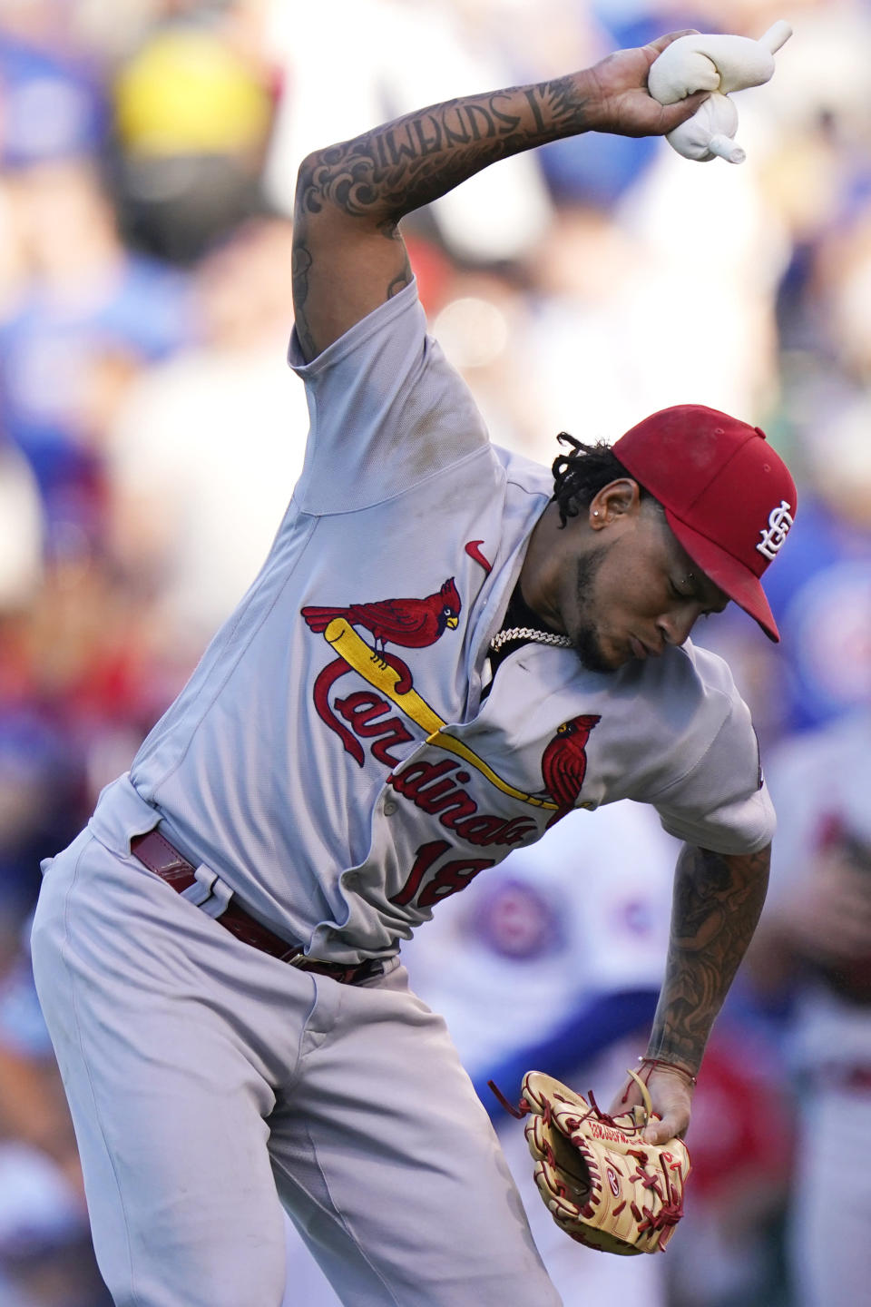 St. Louis Cardinals starting pitcher Carlos Martinez throws the rosin bag on the mound during the third inning of a baseball game against the Chicago Cubs in Chicago, Sunday, June 13, 2021. (AP Photo/Nam Y. Huh)