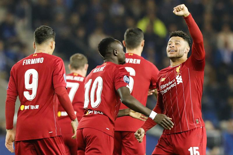 Liverpool's English midfielder Alex Oxlade-Chamberlain (R) celebrates with teammates after scoring a goal during the UEFA Champions League Group E football match between (KRC) Genk and Liverpool on October 23, 2019 at the Luminus Arena in Genk. (Photo by François WALSCHAERTS / AFP) (Photo by FRANCOIS WALSCHAERTS/AFP via Getty Images)