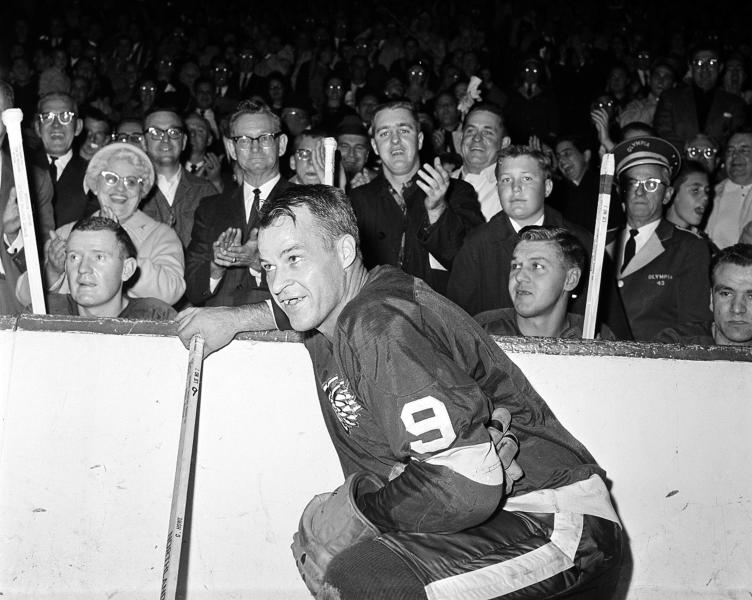 "FILE- In this Nov. 10, 1963 file photo, the Detroit Red Wings' Gordie Howe (9) acknowledges applause from the fans during a 20-minute standing ovation after he scored the 545th cgoal of his National Hockey League career at Detroit's Olympia Stadium, to set the leagues' to set the all-time scoring mark. The NHL has the best names in the business. Nicknames, that is. Little Ball of Hate. The Great One. Tazer. Bicksy. How is known as the ""Mr. Hockey."" (AP Photo/File)"