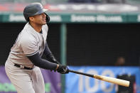 New York Yankees' Gleyber Torres watches his two-run single in the third inning of a baseball game against the Cleveland Indians, Thursday, April 22, 2021, in Cleveland. (AP Photo/Tony Dejak)