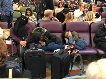 Stranded passengers are seen sleeping at Gatwick Airport, Britain, December 20, 2018 in this picture obtained from social media. Ani Kochiashvili/via REUTERS