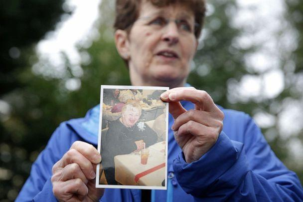 PHOTO: Pat Herrick holds a photo of her mom Elaine Herrick, 89, a resident of Life Care Center who died from COVID-19, in Kirkland, Wash., March 5, 2020. (Jason Redmond/AFP via Getty Images, FILE)