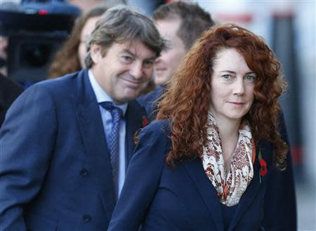 Former News International chief executive Rebekah Brooks and her husband Charlie arrive at the Old Bailey courthouse in London