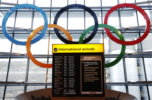 Olympic Rings are revealed during an unveiling ceremony in the Terminal Five arrivals hall at Heathrow Airport, in preparation for the London 2012 Olympic Games in London June 20, 2012. REUTERS/Luke MacGregor (BRITAIN - Tags: TRANSPORT SOCIETY SPORT OLYMPICS)