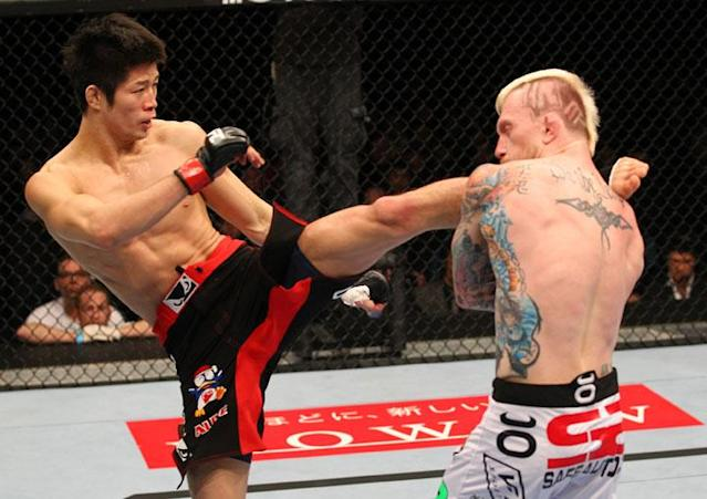 SAITAMA, JAPAN - FEBRUARY 26: (L-R) Hatsu Hioki kicks Bart Palaszewski during the UFC 144 event at Saitama Super Arena on February 26, 2012 in Saitama, Japan.