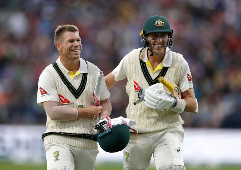 David Warner and Marnus Labuschagne of Australia leave the ground as bad light suspended at Headingley on August 22, 2019 in Leeds, England. (Photo by Ryan Pierse/Getty Images)