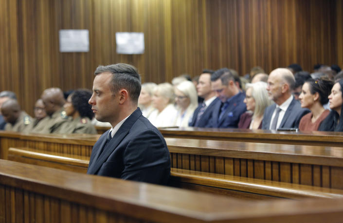 Oscar Pistorius appears in the High Court, for sentencing proceedings, Tuesday, June 14, 2016 in Pretoria, South Africa. An appeals court found Pistorius guilty of murder, and not culpable homicide, for the shooting death of his girlfriend Reeva Steenkamp. (Kim Ludbrook/Pool Photo via AP)