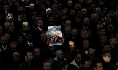 FILE PHOTO: People attend a symbolic funeral prayer for Saudi journalist Jamal Khashoggi at the courtyard of Fatih mosque in Istanbul