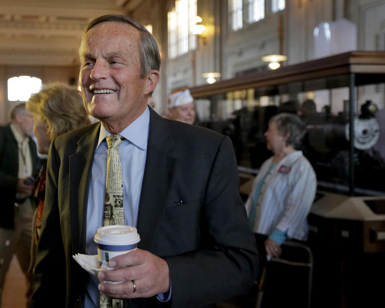 Missouri Senate candidate Rep. Todd Akin, R-Mo., talks to a supporter during a campaign stop at Union Station, Wednesday, Oct. 31, 2012, in Kansas City, Mo. (AP Photo/Charlie Riedel)