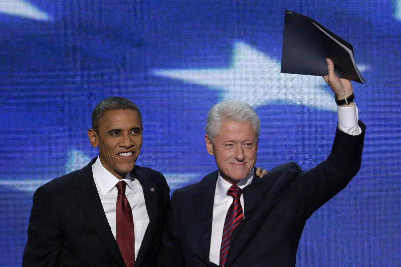 Former President Bill Clinton waves to the delegates as he stands with President Barack Obama after Clinton addressed the Democratic National Convention in Charlotte, N.C., on Wednesday, Sept. 5, 2012. (AP Photo/J. Scott Applewhite)