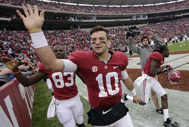 Alabama quarterback AJ McCarron (10) thanks the fans after a 49-0 win over Chattanooga in an NCAA college football game in Tuscaloosa, Ala., Saturday, Nov. 23, 2013. (AP Photo/Dave Martin)