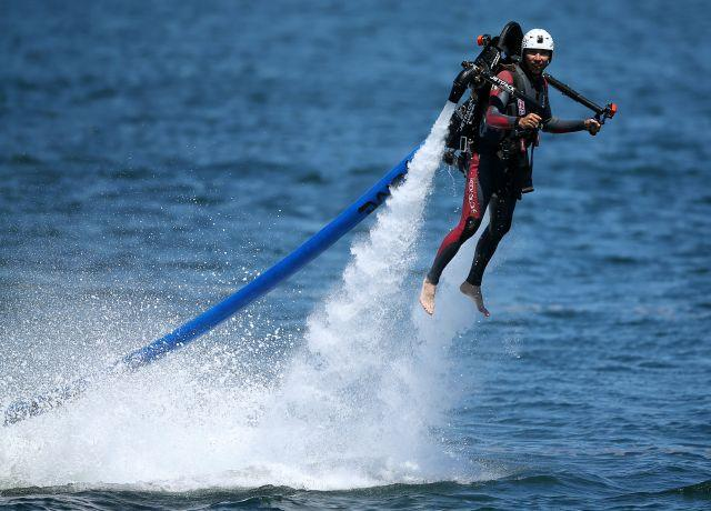 A man flying a water jet pack