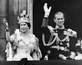 <p>Queen Elizabeth II and the Duke of Edinburgh wave at the crowds from the balcony at Buckingham Palace in June, 1953. </p>