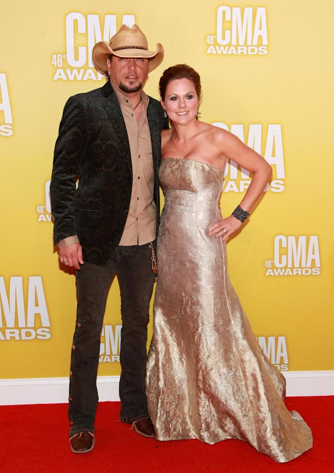 "<p class=""MsoNormal""><span style=""color:black;"">Three-time CMA nominee Jason Aldean made his first red carpet appearance with his wife, Jessica Ussery, since his cheating scandal in late September – and the high school sweethearts were color coordinated. While she opted for a strapless, textured gold gown, the ""Dirt Road Anthem"" singer matched his shirt to the hue … and the country music uniform: cowboy hat, snakeskin boots, and jeans. (11/1/2012)<br></span></p>"