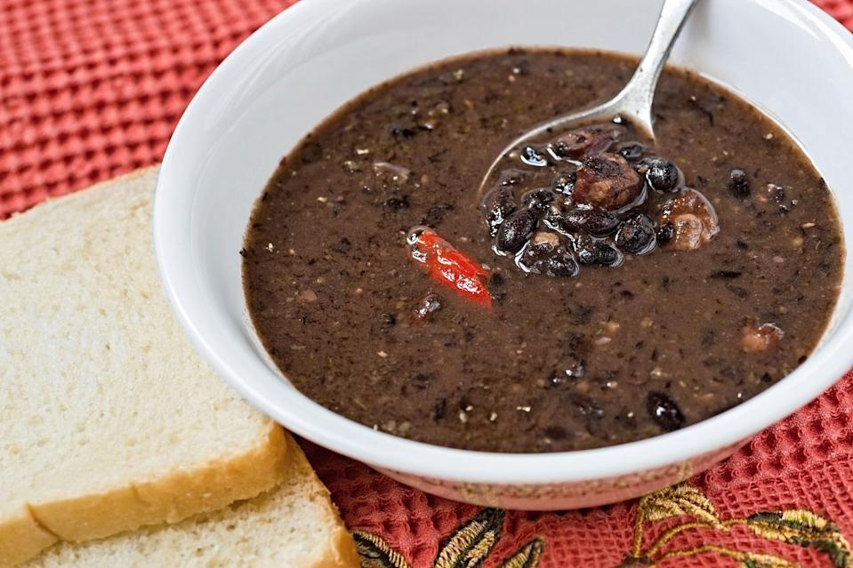 """<p>This simple black bean soup <a href=""""https://www.thedailymeal.com/cook/how-make-panera-black-bean-soup?referrer=yahoo&category=beauty_food&include_utm=1&utm_medium=referral&utm_source=yahoo&utm_campaign=feed"""" rel=""""nofollow noopener"""" target=""""_blank"""" data-ylk=""""slk:tastes exactly like the one you can find at Panera Bread"""" class=""""link rapid-noclick-resp"""">tastes exactly like the one you can find at Panera Bread</a>. If you want to get creative with it, top this dish with avocado, sour cream, shredded cheese or pickled jalapeños.</p> <p><a href=""""https://www.thedailymeal.com/best-recipes/black-bean-soup-vegetarian?referrer=yahoo&category=beauty_food&include_utm=1&utm_medium=referral&utm_source=yahoo&utm_campaign=feed"""" rel=""""nofollow noopener"""" target=""""_blank"""" data-ylk=""""slk:For the Black Bean Soup recipe, click here."""" class=""""link rapid-noclick-resp"""">For the Black Bean Soup recipe, click here.</a></p>"""