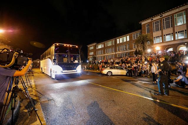 <p>One of the buses carrying students from Marjory Stoneman Douglas High School arrive at Leon High School, prior to their meetings the next day with Florida state legislators, following last week's mass shooting on their campus, in Tallahassee, Fla., Feb. 20, 2018. (Photo: Colin Hackley/Reuters) </p>