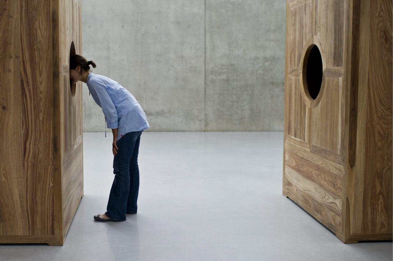 "A visitor looks at the installation ""Moon Chest"" by Chinese artist Ai Weiwei, during the exhibition ""Art and Architecture"" at the Kunsthaus Bregenz in Bregenz, Austria, Thursday, July 14, 2011. The Ai Weiwei ""Art and Architecture"" exhibition lasts from July 16 to October 16, 2011. (AP Photo/Keystone/Ennio Leanza) GERMANY OUT AUSTRIA OUT"