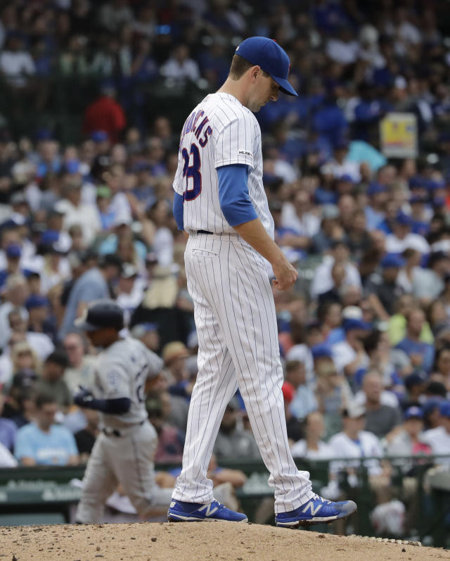 Chicago Cubs starting pitcher Kyle Hendricks, foreground, looks down after San Diego Padres' Francisco Mejia hit a solo home run during the seventh inning of a baseball game in Chicago, Sunday, July 21, 2019. (AP Photo/Nam Y. Huh)