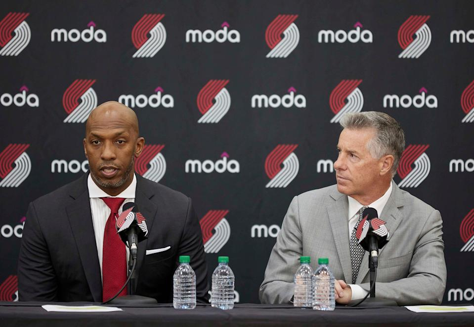 When the Blazers introduced Chauncey Billups as their new head coach on June 29, Neil Olshey (right) said that the franchise conducted a thorough investigation into the rape allegations against Billups.