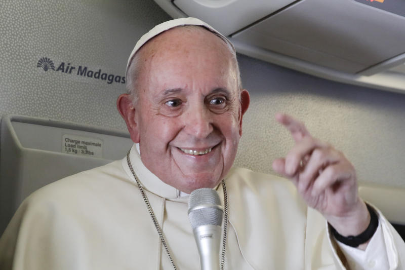 Pope Francis addresses journalists during his flight from Antamanarivo to Rome, Tuesday, Sept. 10, 2019, after his seven-day pastoral trip to Mozambique, Madagascar, and Mauritius. (AP Photo/Alessandra Tarantino)