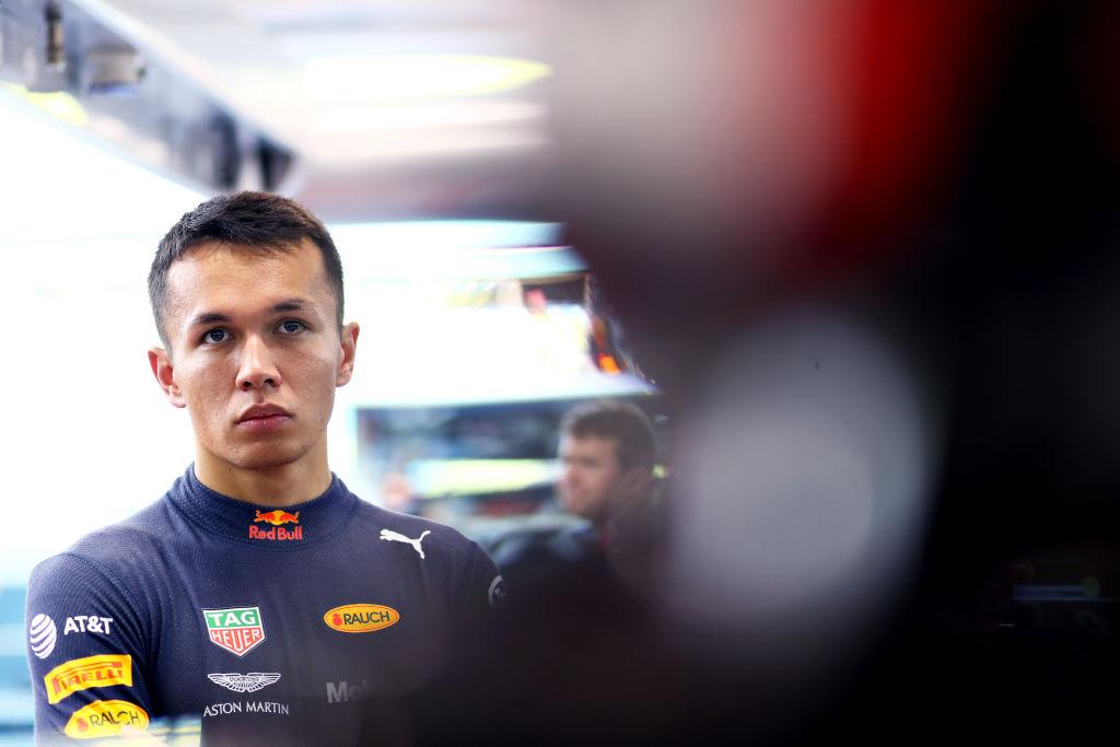 SINGAPORE - SEPTEMBER 21: Alexander Albon of Thailand and Red Bull Racing prepares to drive in the garage during final practice for the F1 Grand Prix of Singapore at Marina Bay Street Circuit on September 21, 2019 in Singapore. (Photo by Mark Thompson/Getty Images)