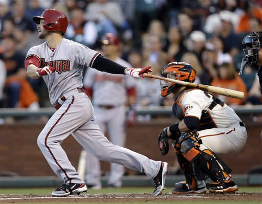 Arizona Diamondbacks' Cody Ross drives in two runs with a bases-loaded single against the San Francisco Giants during the first inning of a baseball game on Monday, April 22, 2013 in San Francisco. (AP Photo/Marcio Jose Sanchez)