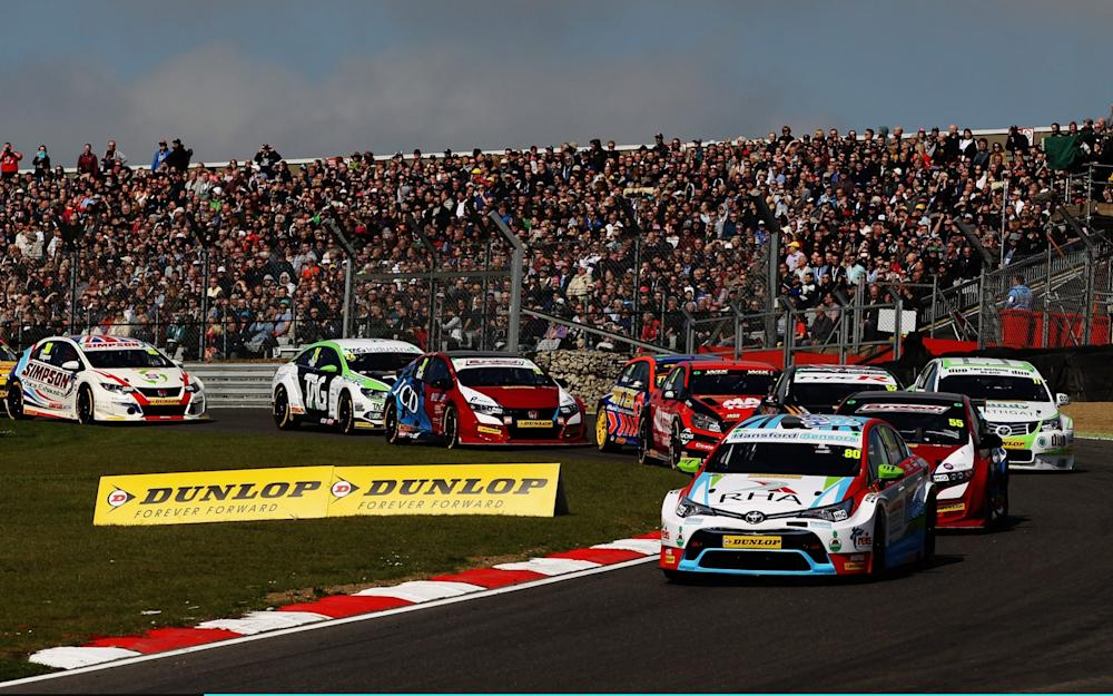 Tom Ingram of Speedworks Motorsport Toyota leads the field into Paddock Hill Bend on lap one on his way to winning round one of the Dunlop MSA British Touring Car Championship at Brands Hatch on April 2, 2017 in Longfield, England - Credit: Ker Robertson/Getty