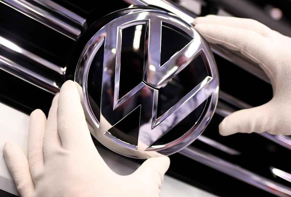 A Volkswagen badge on a production line at the Volkswagen plant in Wolfsburg, Germany. Photo: Reuters/Fabian Bimmer