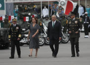 Mexican President Andres Manuel Lopez Obrador, second right, and first lady Beatriz Gutierrez Muller, walk with Secretary of Defense Luis Crescencio Sandoval, right, and Secretary of the Navy, Vidal Francisco Soberon, during the annual Independence Day military parade in Mexico City's main square of the capital, the Zócalo, Wednesday, Sept. 16, 2020. Mexico celebrates the anniversary of its independence uprising of 1810. ( AP Photo/Marco Ugarte)