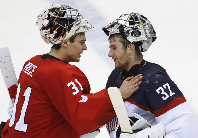 Canada goaltender Carey Price greets USA goaltender Jonathan Quick after the 1-0 Canada win in the men's semifinal ice hockey game at the 2014 Winter Olympics, Friday, Feb. 21, 2014, in Sochi, Russia. (AP Photo/Matt Slocum)