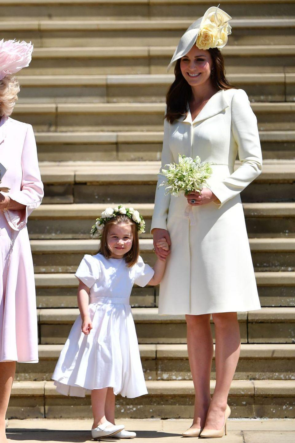 """<p>The Duchess donned a yellow Alexander McQueen coat for the royal wedding of the year—when <a href=""""https://www.harpersbazaar.com/celebrity/latest/a13945302/prince-harry-meghan-markle-royal-wedding/"""" rel=""""nofollow noopener"""" target=""""_blank"""" data-ylk=""""slk:Prince Harry wed Meghan Markle"""" class=""""link rapid-noclick-resp"""">Prince Harry wed Meghan Markle</a>. She paired it with a coordinating floral fascinator. </p>"""