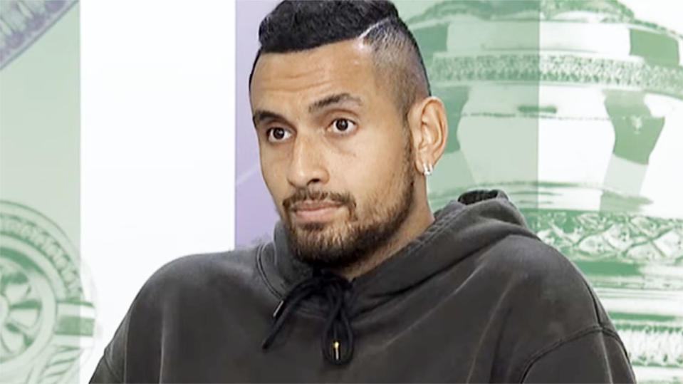 Nick Kyrgios, pictured here speaking to the media after his first-round win at Wimbledon.