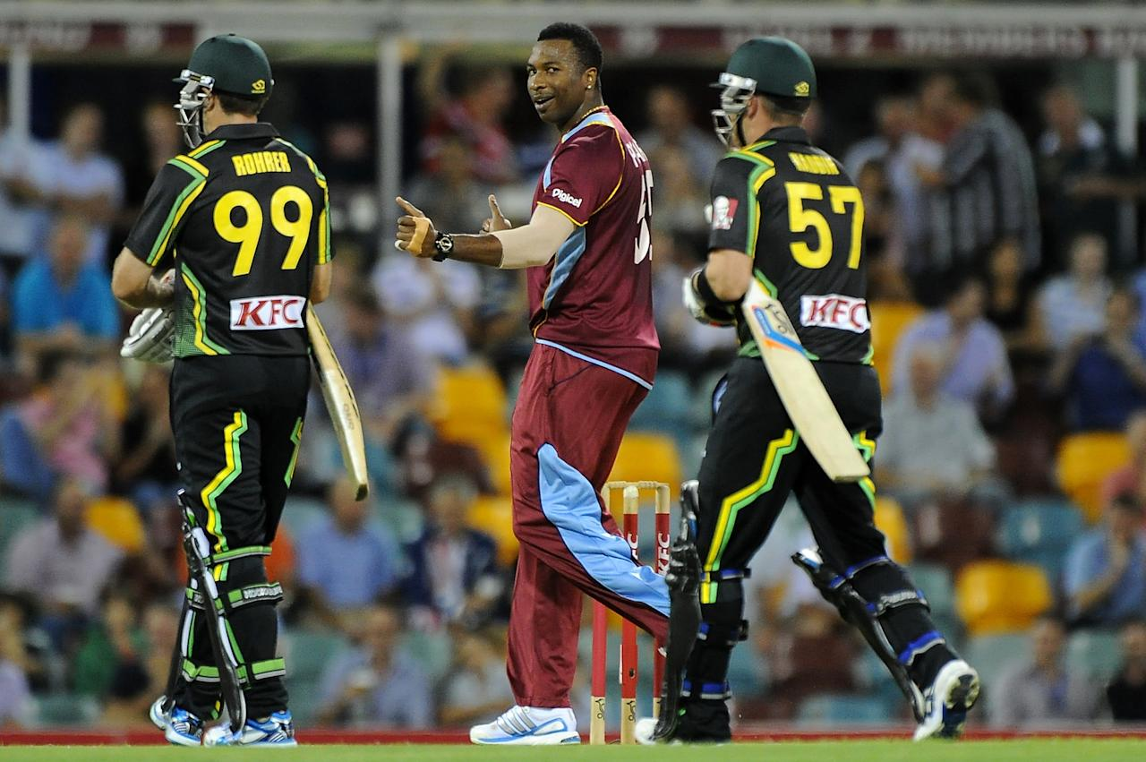 BRISBANE, AUSTRALIA - FEBRUARY 13:  Kieron Pollard of the West Indies celebrates a wicket during the International Twenty20 match between Australia and the West Indies at The Gabba on February 13, 2013 in Brisbane, Australia.  (Photo by Matt Roberts/Getty Images)