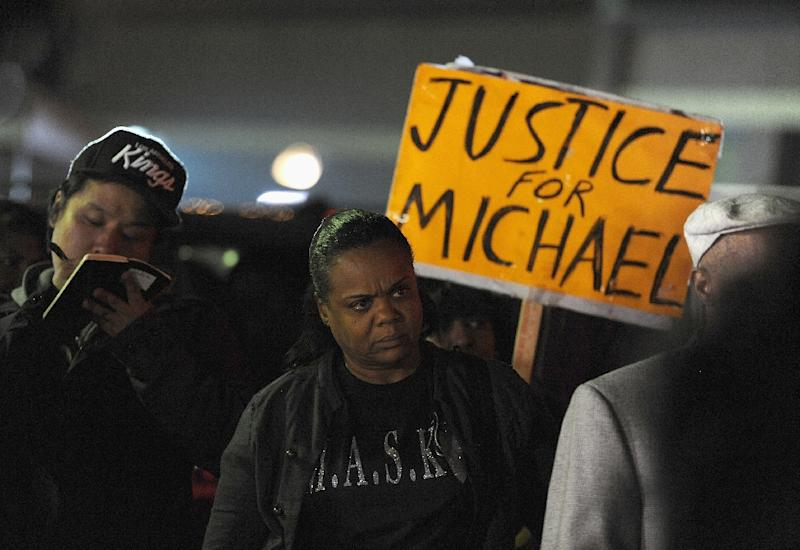 Protestors demonstrate outside the Ferguson Police Department in Ferguson, Missouri on March 12, 2015 (AFP Photo/Michael B. Thomas)