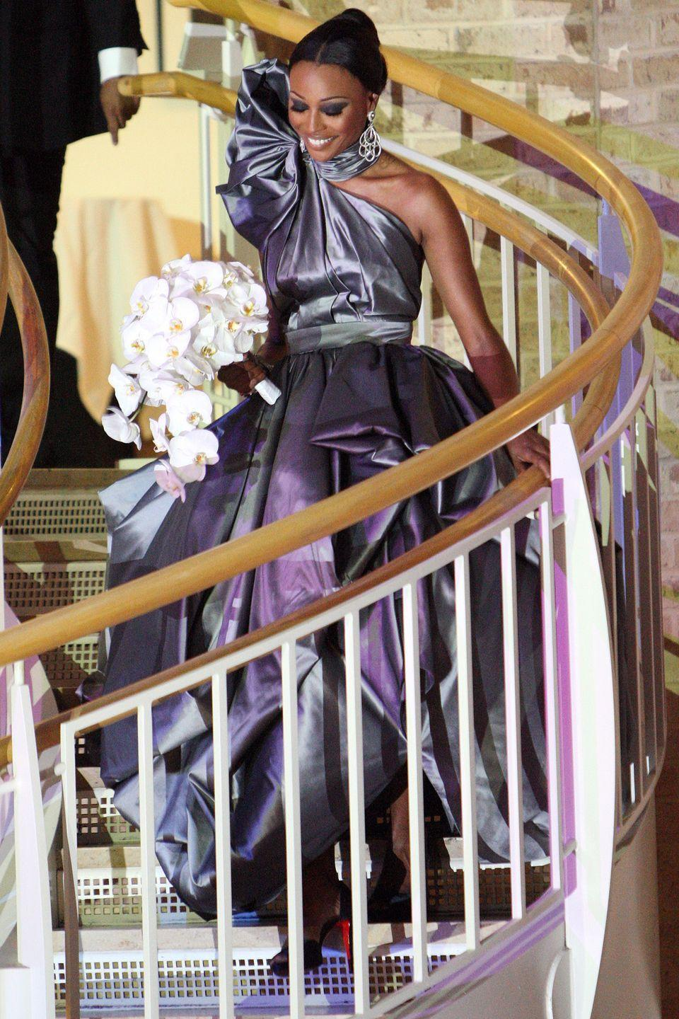 "<p>For the <em>Real Housewives of Atlanta </em>star's wedding to Peter Thomas, she went as far away from a white dress as she could, wearing instead a platinum-colored gown custom made by designer Rubin Singer. She said her modern venue, Fernbank Museum of Natural History in Atlanta, was <a href=""https://www.brides.com/story/real-housewives-atlanta-cynthia-bailey-wedding-dress-style-bridal-gown-budget"" rel=""nofollow noopener"" target=""_blank"" data-ylk=""slk:her inspiration"" class=""link rapid-noclick-resp"">her inspiration</a>.</p>"