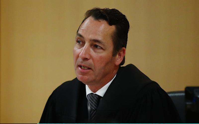Judge Evangelos Thomas speaks as a man accused of Grace Millane's murder appears in court in Auckland - Getty Images AsiaPac