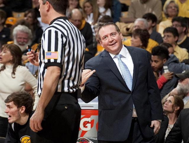 Southern Mississippi head coach Donnie Tyndall discusses a call with the referee during the first half of an NCAA college basketball game against Missouri in the second round of the NIT tournament Sunday, March 23, 2014, in Columbia, Mo. Southern Mississippi won 71-63. (AP Photo/L.G. Patterson)