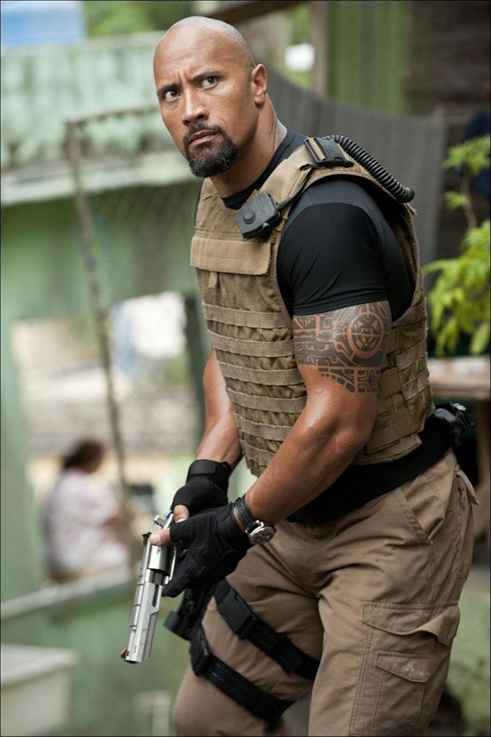 "<p>Dwayne ""The Rock"" Johnson has been a collegiate football player, wrestling champion, and scorpion king, but in his most famous film role, he plays a government agent who flexes his way out of an arm cast, falls like a champ out of a multi-story building, and takes out a drone with an ambulance.</p>"
