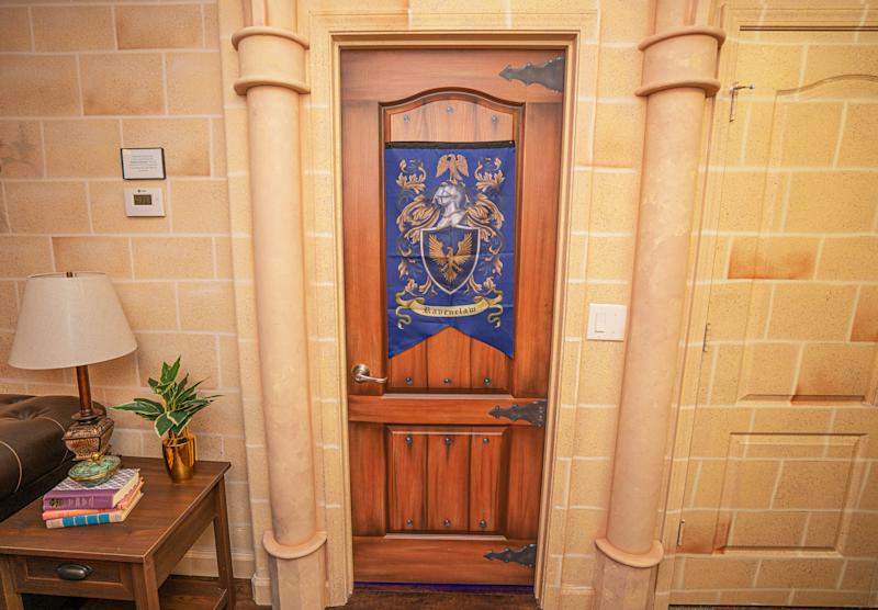 PIC BY @LOMA HOMES / CATERS NEWS AGENCY (PICTURED- A door with the Ravenclaw symbol ) - Harry Potter fans looking for a first post-lockdown trip can put this place at the top of their list - a night in a Hogwarts- themed Airbnb. The eight-bedroom home, called ' Wizard's Way' is based in Florida, US, near the Universal Orlando Resort. There are rooms based on the four houses Gryffindor, Hufflepuff, Ravenclaw, and Slytherin and each bathroom has its own Harry Potter theme, from Hedwig and the Ministry of Magic to Dobby, and Sirius Black. One of the bedrooms features an interactive car-shaped bed which is inspired by the scene where Harry and Ron get stuck in the Willow Tree of the second part of the film series. - SEE CATERS COPY