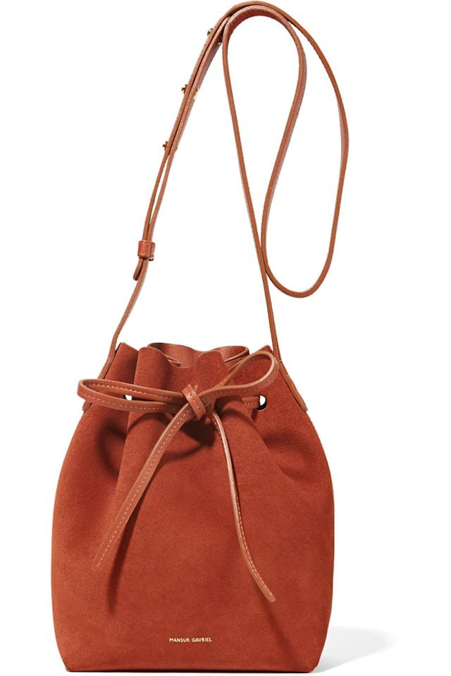 "<p>And needs one that's up to the task.</p><p><em>Mini bucket bag in moss (</em><em>$495) by Mansur Gavriel, </em><em><a rel=""nofollow"" href=""https://www.net-a-porter.com/us/en/product/756418"">net-a-porter.com</a></em></p>"