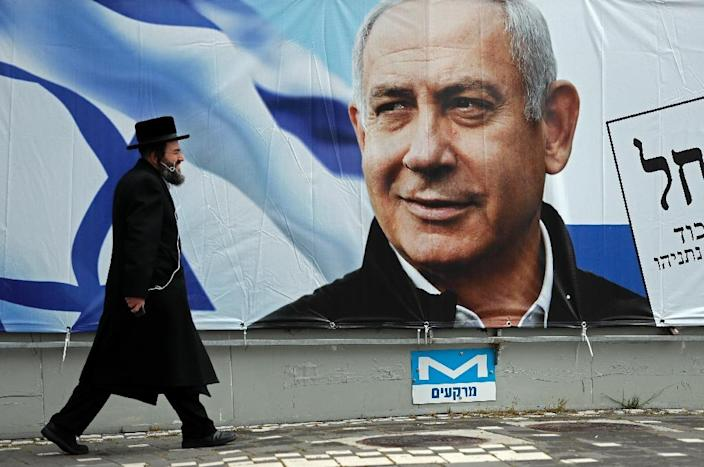Bolstered by his reputation as guarantor of Israel's security and economic growth, Netanyahu has spent more than 13 years as premier (AFP Photo/THOMAS COEX)