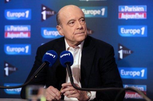 <p>Founder of the French opposition right-wing UMP party, Alain Juppe, answers journalists' questions on November 25. Ex-president Nicolas Sarkozy on Monday waded in to a bitter leadership battle that has left France's main right-wing opposition party, the UMP, on the verge of collapse.</p>