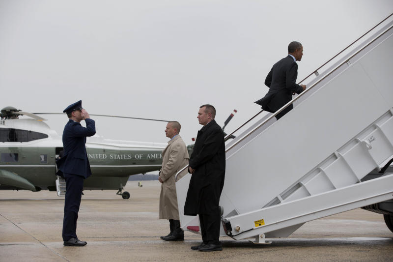 "President Barack Obama boards Air Force One at Andrews Air Force Base, Md., Wednesday, Feb. 19, 2014, prior to traveling to Toluca, Mexico to participate in the seventh trilateral North American Leaders Summit Meeting, where he will meet with Canadian Prime Minister Stephen Harper and Mexican President Enrique Peña Nieto. This year's theme is ""North American Competitiveness.""(AP Photo/Jacquelyn Martin)"