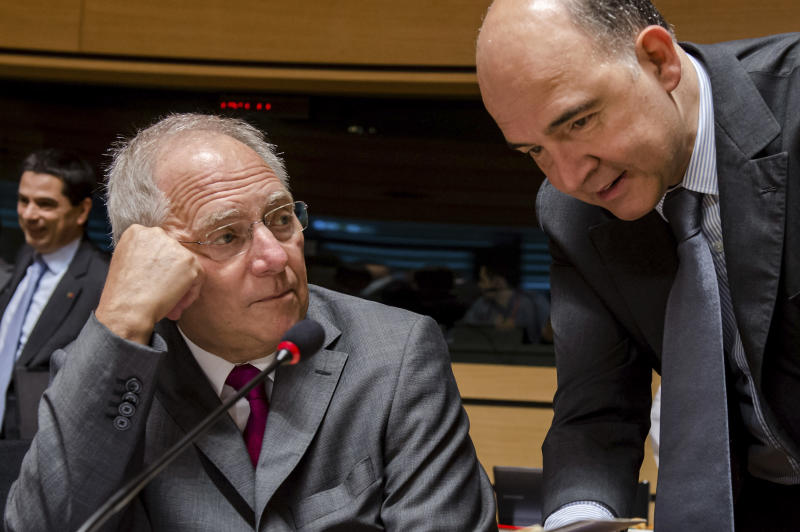 German Finance Minister Wolfgang Schauble, left, talks with his French counterpart Pierre Moscovici during a European finance ministers meeting in Luxembourg, Friday, June 21, 2013. (AP Photo/Geert Vanden Wijngaert)