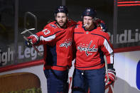 Washington Capitals right wing Tom Wilson (43) celebrates his goal against the Philadelphia Flyers with right wing Anthony Mantha (39) during the first period of an NHL hockey game Tuesday, April 13, 2021, in Washington. (AP Photo/Nick Wass)