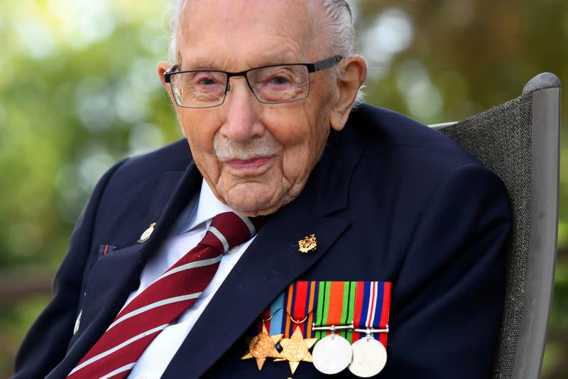 FILE PHOTO: Captain Sir Tom Moore smiles as he launches his autobiography book at his home in Milton Keynes